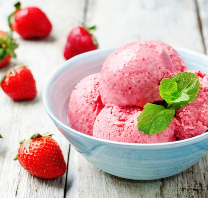 strawberry ice cream on a white background wood. toning. selective focus